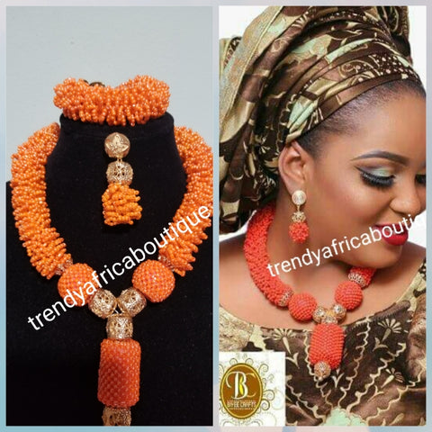 "Original Coral-necklace set. Small coral beads in cluster necklace for Nigerian traditional use. Sold with matching bracelet and earrings. Bracelet fit 7-8"" wrist"