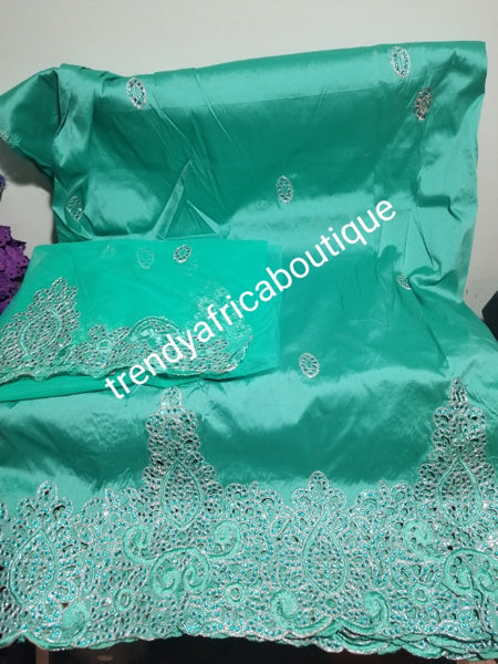 Back in stock: Mint green embriodery George fabric. Top quality Indian-George for making Nigerian/African party dress. 5yds silk George + 1.8yds matching net blouse. Contact us if you are interested in Aso-ebi order