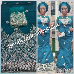 New arrival of Teal color Silk embroidery george. Embriodered with gold. Super quality Indian-George for making Aso-ebi dresses, Nigerian party dress. Contact us for group order. Sold as 5yds + 1.8yds matching  net for blouse combo