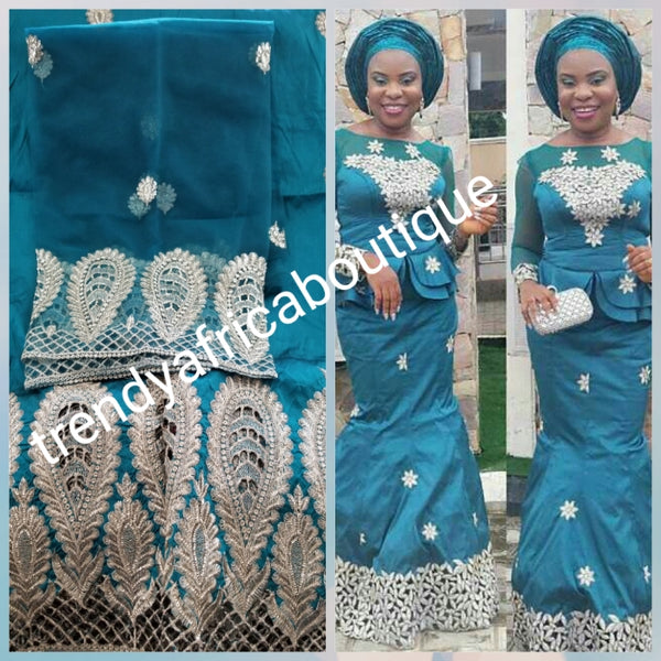 Teal green Embriodery Nigerian wedding George fabric and net blouse. Come 5yds +1.8yds wrapper. New arrival aso-ebi Silk George. Sold as a set. Small-George for Nigerian party dress