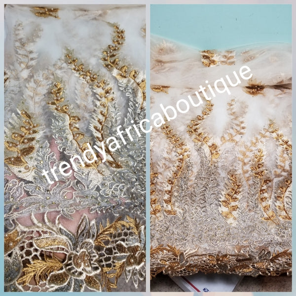 Clearance:. Classic Embriodery Net  beaded and stoned George  lace fabric. Original quality. Sold per 5yds. Beige/Gold embriodery. African French lace/George wrapper.