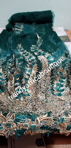 Green/gold Net French fabric, Luxery Embriodery  African french lace fabric. Beaded and stoned to perfection. Sold per 5yds price is for 5yds. Beautiful border handcut embriodery work