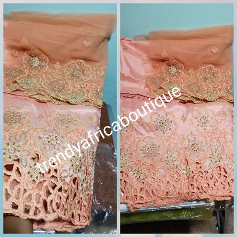 Latest design Indian-George wrapper. Embriodery peach silk george with crystal stones on  hand cut border. 5yd+ 1.8yds matching blouse. Lustrous quality. Aso-ebi George. Need to order for group, contact us directly