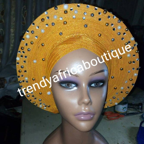 Gold Auto-gele made with quality Aso-oke. Beaded and stoned quality hand work. One size fit, easy to adjust for fit and knot at the back