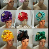 Assorted colors women-turban. One size fit hair turban. Beautiful flower design with a side brooch to add decor to your turban