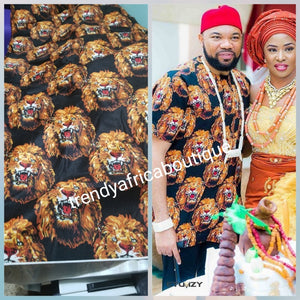 New arrival Isi-agu Igbo traditional/ceremonial fabric for men or womem. Lion head  print.  Sold per one yard. Price is for a yard. Can be use for wrapper, blouse or shirt for men. Black/Gold