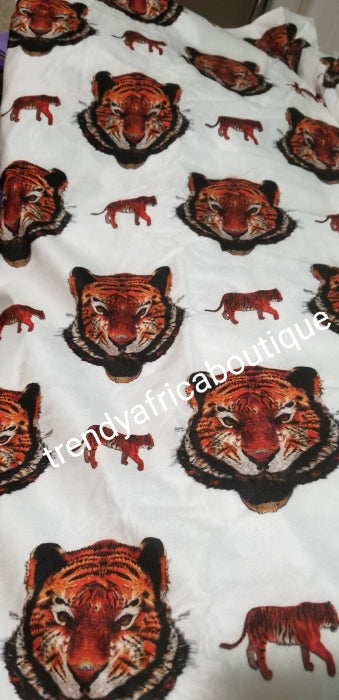 New arrival Isi-agu Igbo traditional/ceremonial fabric for men or womem. Tiger head fabric. Sold per one yard. Price is for a yard. Can be use for wrapper, blouse or shirt for men. White background with black/red tiger head