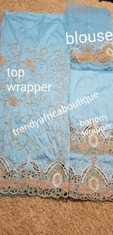 "Clearance  sky blue VIP George for Nigerian/Igbo/delta Traditional weddings/birthdays and more wrapper + 1.8yds net fabric for making blouse. Sold as. A set of wrapper and blouse. Original quality silk. ""Feel the difference in Quality"""