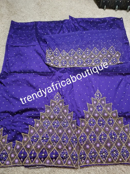 Sale: quality Celebrants purple Hand stoned silk George wrapper for Nigerian party outfit. Sold per set of 5yds+1.8yds net for making a blouse. All over stones with master piece design.