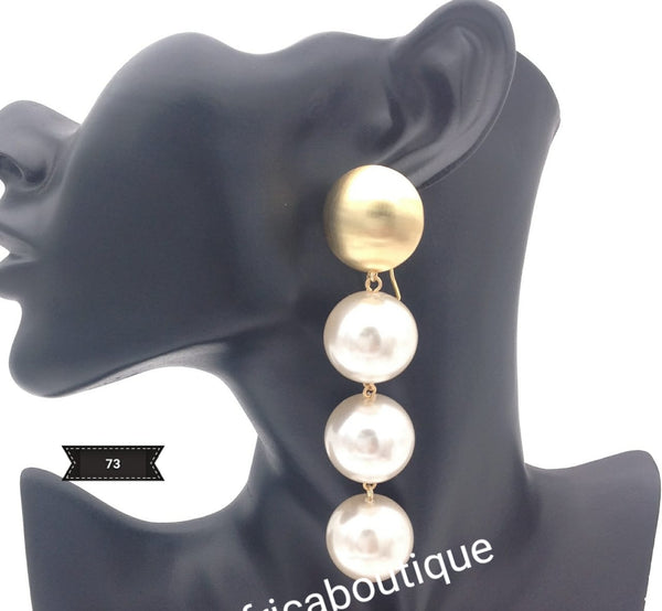 Latest drop-earrings in gold and white pearls. Top quality made hypoallergenic