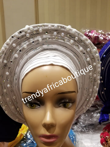 Pure white Auto-gele. Nigerian aso-oke made into auto gele. beaded and stoned to perfection.  Party ready in less than 5 minutes. One size fit, easy adjustment at the back. Made with quality aso-oke. Big design with white beads and stones
