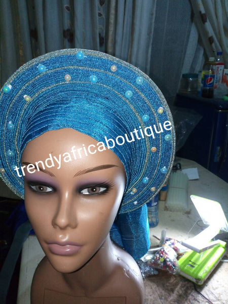 Turquoise blue/silver auto-gele. One size fit all. Wahala free gele, party ready in seconds. New arrival beaded and  aso-oke gele already made