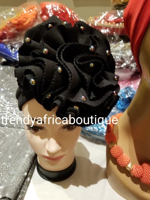 Black women-turban. One size fit hair turban. Beautiful flower design with a side brooch to add decor to your turban
