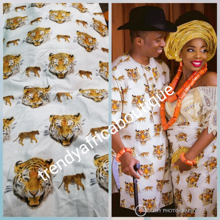Sale; Original quality white/Gold Isi-agu wrapper, Igbo traditional wrapper use by men or women. Sold per yard, price is for one yard. Nigerian/igbo ceremonia fabric. Soft texture, authentic isi-agu fabric. Igbo Tiger head fabric.
