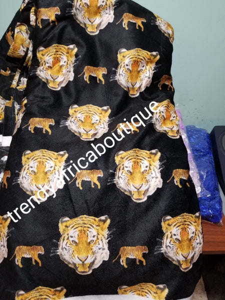 Sale; Original quality Black/Gold/white tiger head/ Isi-agu wrapper, Igbo traditional wrapper use by men or women. Sold per yard, price is for one yard. Nigerian/igbo ceremonia fabric. Soft texture, authentic isi-agu fabric. Igbo Tiger head fabric.