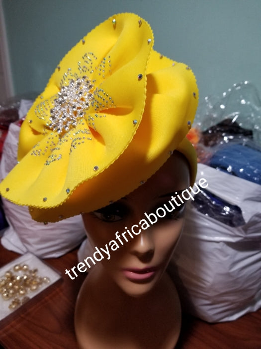 Yellow color Women-turban. One size fit all turban. Beautiful flower design with a side brooch to add decor to your head wrap accessories. Head wrap made ready