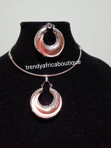 Latest high quality silver plated hoop pendant/earrings set with Omega chain. 2 tone pendant/earrings. Sold as a set. Price is for the set. The chain have extender with the hook at the back for fitting adjustment