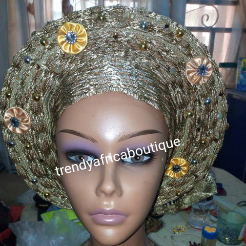 New arrival of Champagne gold auto-gele made with basket aso-oke/original quality Nigeria aso-oke woven.  Auto-gele Party ready in less than 5 minutes. One size fit, easy adjustment at the back
