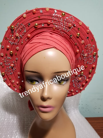 Sweet Coral Auto-gele made with quality Aso-oke. Beaded and stoned work front and back to perfection. One size fit, easy to adjust for fit and knot at the back to secure your gele. This is true original auto gele