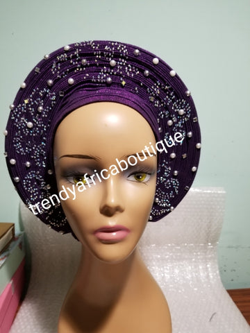 Sweet Purple Auto-gele made with quality Aso-oke. Silver stoned work to perfection. One size fit, easy to adjust for fit and knot at the back to secure your gele. This is true original auto gele