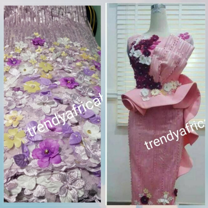 New arrival french lace fabric. Beautiful 3D flower border made to perfection. Ideal for evening gown, or Nigerian traditional wedding outfit. This color is lilac with purple multi color petals. Sold per 5yds