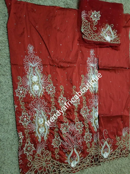 Ready to ship. Exclusive Wine Red Madam/celebrant Nigerian George wrapper. Beaded and stoned with hand cut border. Special occasion wrapper. 5yds + 1.8yds matching net (now sewn) for blouse. Tradtional Igbo/Delta Bridal outfit