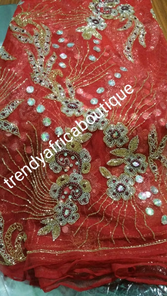 Clearance item: tomato Red Net George wrapper fabric. 6.5yds total. Fully beaded and stoned for making red carpet dresses  for Nigerian weddings/ceremonies. Celebrant model wearing same material.