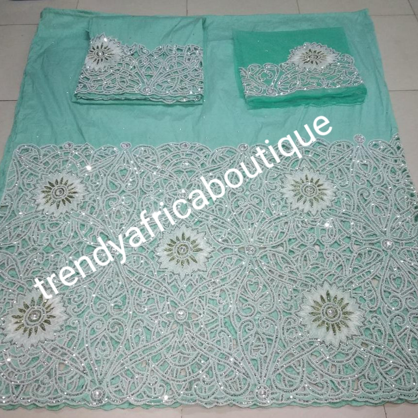 Ready to ship:  Big VIP Nigerian Celebrant Silk George wrapper. All over white crystal stones/beads in hand cut flower design on water Green silk George. 2 wrapper (2.5yd each) + 1.8yds net blouse. Igbo bride