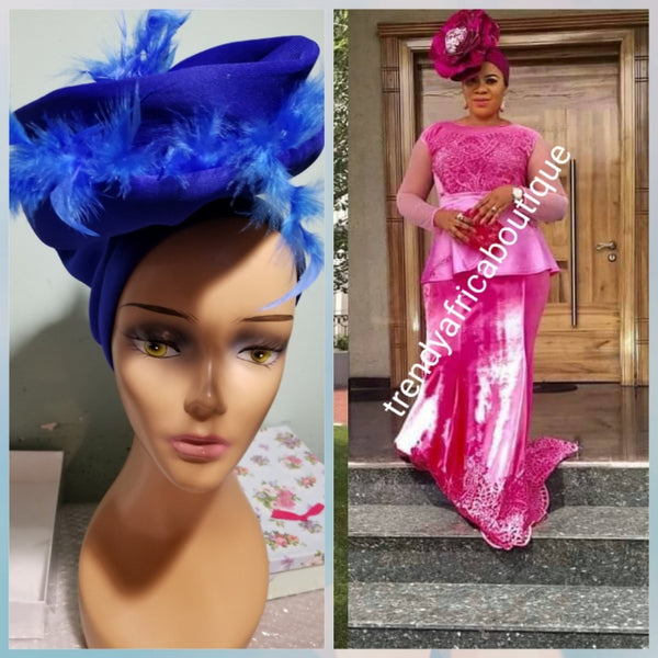 Royal blue color Women-turban. One size fit all turban. Beautiful feather design with a side brooch to add decor to your turban