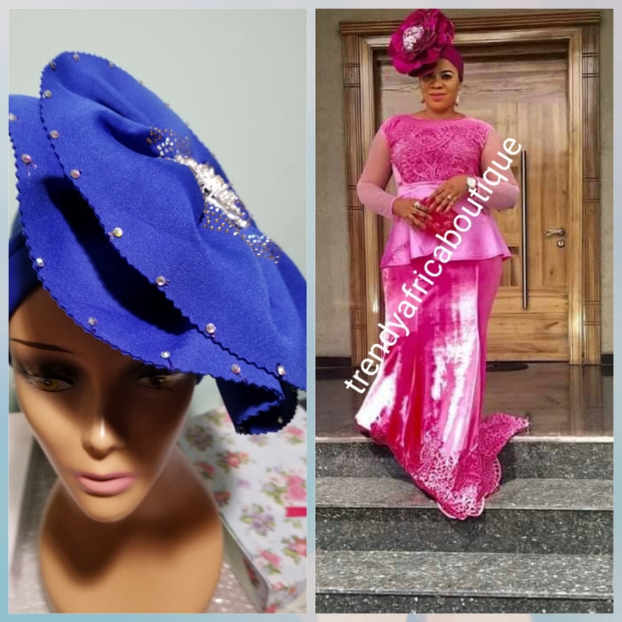 Royal blue color Women-turban. One size fit all turban. Beautiful flower design with a side brooch/ embellished with crystal stones to add decor to your turban