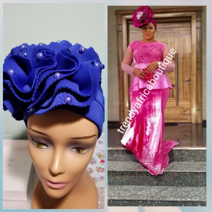 Royal blue color Women-turban. One size fit all turban. Beautiful flower design with a side brooch/beaded and stoned to add decor to your turban