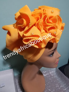 Orange  color Women-turban. One size fit all turban. Beautiful flower design with a side brooch/ embellished with beads to add decor to your turban