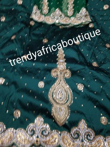 SALE,SALE- New arrival Nigerian Tranditional wedding George wrapper. Embellished with quality dazzling beads/crystal stones design in rich Green. Full 5yds + 1.8yds matching blouse + free headtie. Indian-George.