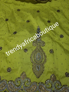 SALE,SALE- New arrival Nigerian Tranditional wedding George wrapper. Embellished with quality dazzling beads/crystal stones design in rich yellow. Full 5yds + 1.8yds matching blouse. Indian-George.