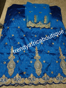 SALE,SALE- New arrival Nigerian Tranditional wedding George wrapper. Embellished with quality dazzling beads/crystal stones design in beautiful Turquoise blue. Full 5yds + 1.8yds matching blouse + free headtie. Indian-George.