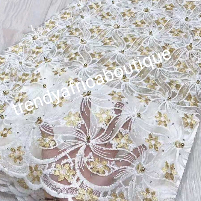 Latest design: African French lace fabric embellished with beads & stones all over to perfection. Sold per 5yds. Nigerian Bridal lace fabric white/gold