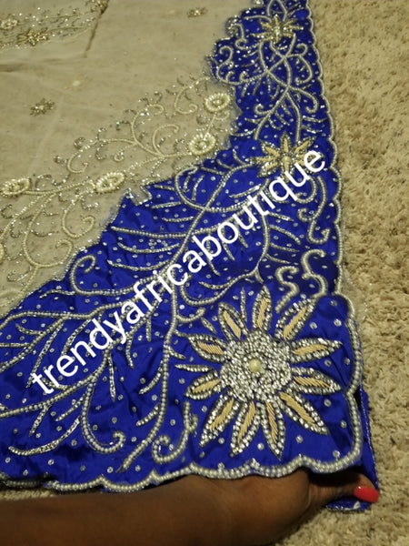 Latest Design: ready to ship White beaded and hand stoned Net/Royal blue taffeta combo on border and side. Gorgeous Igbo Traditional Bridal outfit- quality hand work to perfection. George wrapper and matchimg net blouse. 6.8yds total