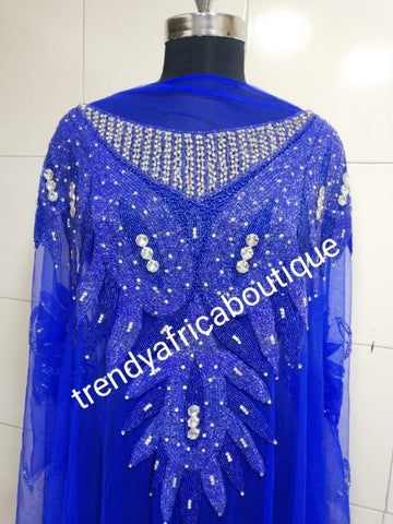 Royal blue Heavily-beaded net for making blouses. Popularly use by Igbo/Delta/edo women for big Occasions. Comes in 1.8yds lenght already design for your beautiful blouse