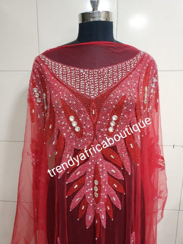 Red Heavily-beaded net for making blouses. Popularly use by Igbo/Delta/edo women for big Occasions. Comes in 1.8yds lenght already design for your beautiful blouse