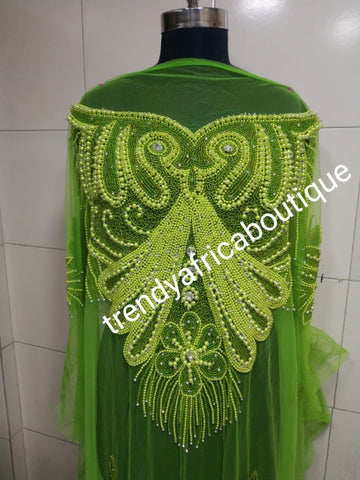 Lemon green Heavily-beaded net for making blouses. Popularly use by Igbo/Delta/edo women for big Occasions. Comes in 1.8yds lenght already design for your beautiful blouse