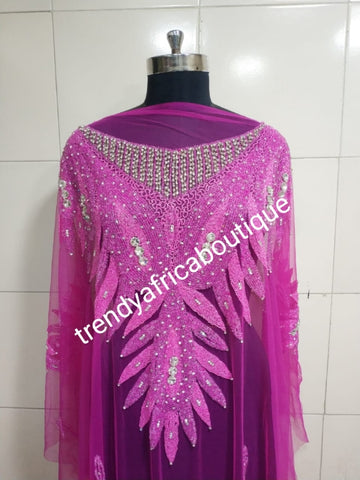 Fuschia pink Heavily-beaded net for making blouses. Popularly use by Igbo/Delta/edo women for big Occasions. Comes in 1.8yds lenght already design for your beautiful blouse