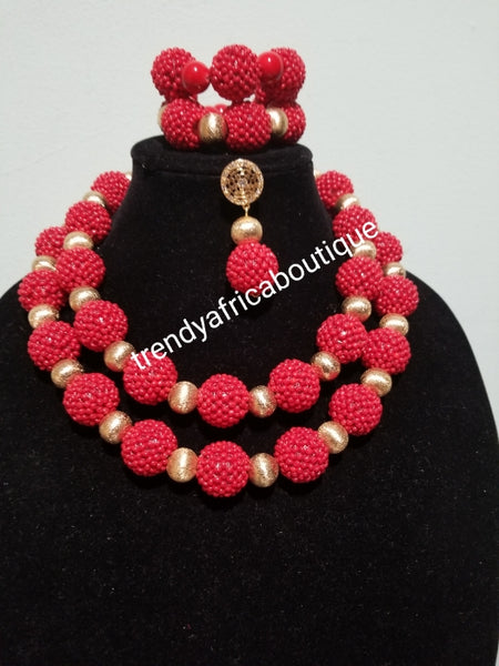 Back in stock: 3 piece set of Coral-necklace. Smaller red coral in cluster beads compliment with Gold beads. Matching 2  bracelet and earrings. Sold as a set, price is for the set. Nigerian traditional wedding beads.