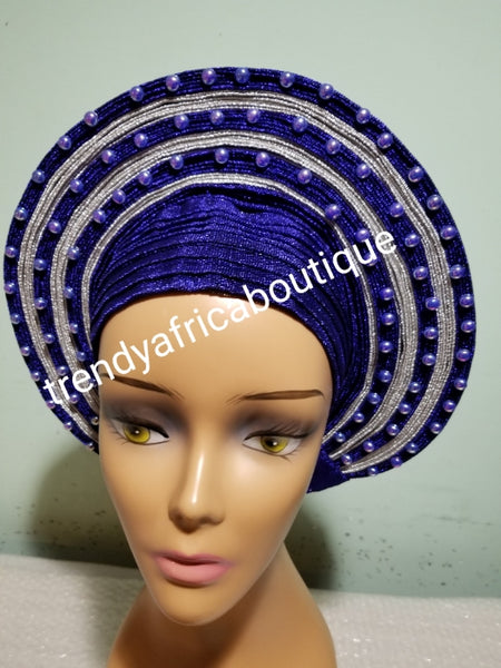Royal blue/silver embellished with beads auto-gele. Wahala free gele aleeady made for you. One piece with adjustment for proper fit at the back. Original quality from Nigeria.