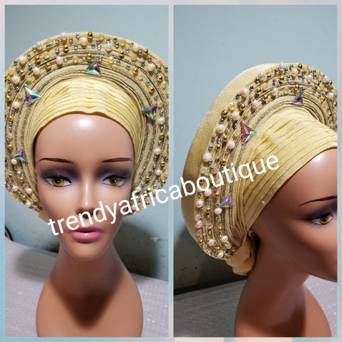 Cream  embellished with beads auto-gele. Wahala free gele aleeady made for you. Easy adjustment for proper fit at the back. Original quality from Nigeria.
