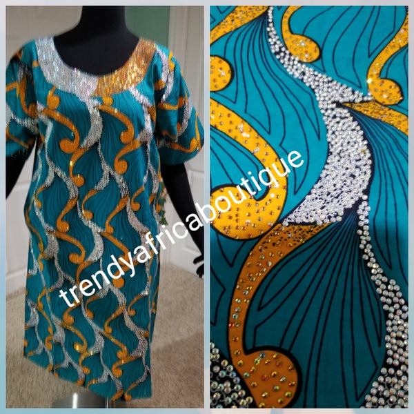 "Embriodered and stoned multi color Ankara-kaftan, short dress embellished with shinning Swarovski stones to perfection! Fit Burst 44"" and Full lenght 43"". Made with Quality Ankara/stoned work."