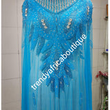Turquoise blue Heavily-beaded net for making blouses. Popularly use by Igbo/Delta/edo women for big Occasions. Comes in 1.8yds lenght already design for your beautiful blouse
