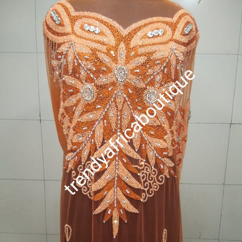Orange color Heavily-beaded net for making blouses. Popularly use by Igbo/Delta/edo women for making modern big Occasion BlouseComes in 1.8yds lenght already design for your beautiful blouse