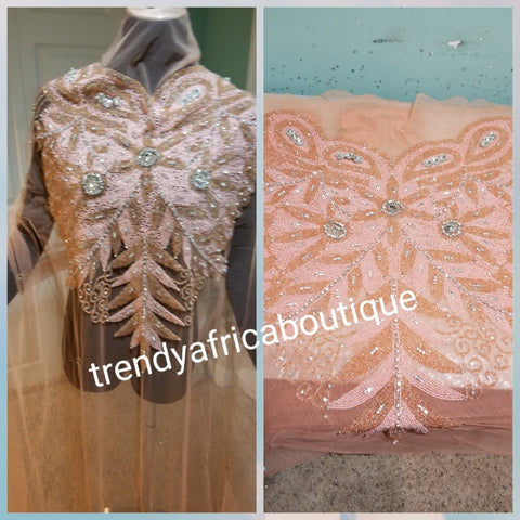 "Sweet peach  Heavily-beaded net for making modern blouses. Popularly use by Igbo/Delta/edo women for big Occasions. Comes in 1.8yds lenght already design for your beautiful blouse. 1.8yds × 55"" width."