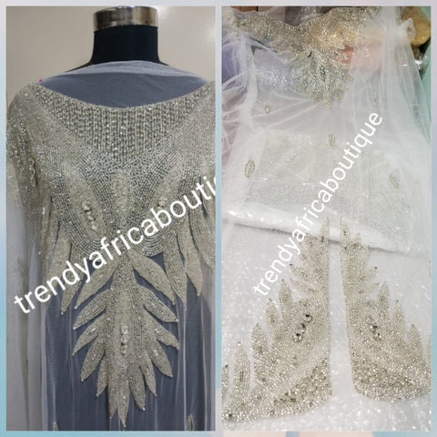 "Pure white Heavily-beaded net for making modern blouses. Popularly use by Igbo/Delta/edo women for big Occasions. Comes in 1.8yds lenght already design for your beautiful blouse. 1.8yds × 55"" width."