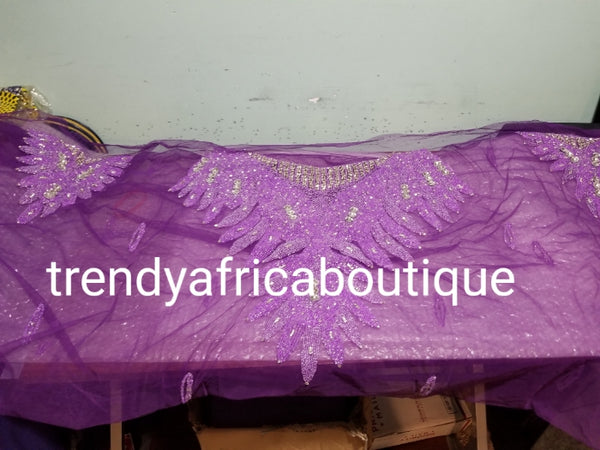 Purple Heavily-beaded net for making blouses. Popularly use by Igbo/Delta/edo women for making modern blouse for big Occasions. Comes in 1.8yds lenght already design for your beautiful blouse